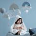 Camcam Copenhagen muziekmobielen meisje met badcape en speen